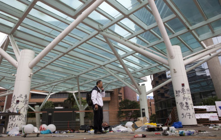 Professor Alex Wai, Vice President of the Polytechnic University, takes in the vandalized campus as he leads a team of school officials and first aid providers.