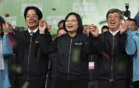 Taiwan's 2020 presidential election candidate, Taiwanese President Tsai Ing-wen, center, anf her running mate William Lai, left, celebrate their victory with supporters in Taipei, Taiwan, Saturday, Jan. 11, 2020.