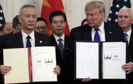 President Donald Trump holds the signed a trade agreement with Chinese Vice Premier Liu He, in the East Room of the White House, Wednesday, Jan. 15, 2020, in Washington.