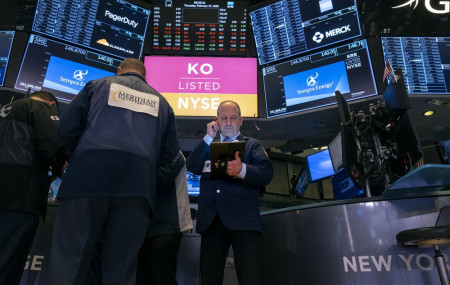 Traders work on the floor of the New York Stock Exchange Thursday, Feb. 27, 2020.