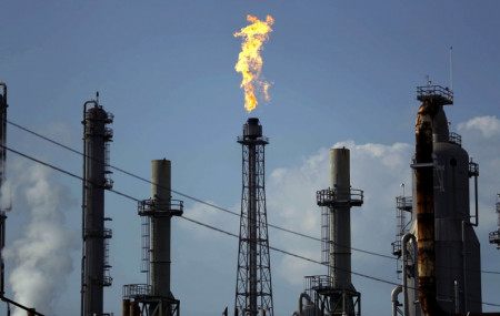 In this Thursday, Aug. 31, 2017, file photo, a flame burns at the Shell Deer Park oil refinery in Deer Park, Texas.