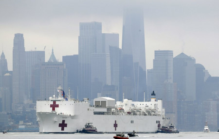 The Navy hospital ship USNS Comfort passes lower Manhattan on its way to docking in New York, Monday, March 30, 2020. The ship has 1,000 beds and 12 operating rooms.