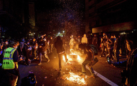Demonstrators burn garbage in Oakland, Calif., on Friday, May 29, 2020, while protesting the Monday death of George Floyd, a handcuffed black man in police custody in Minneapolis.