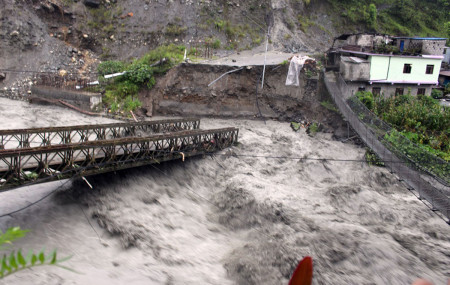 The bridge over Raghuganga river at the border of Galeshwore in Beni municipality 9 and Rahughat of Raghuganga rural municipality 3 in Myagdi destroyed by floods. Photo: Santosh Gautam/RSS