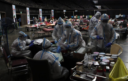 In this Wednesday, July 8, 2020, file photo, doctors and nurses work at a COVID-19 isolation center in Mumbai, India.