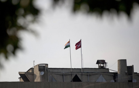 In this Aug. 9, 2019, file photo, an Indian national flag, left, is hoisted next to a Jammu and Kashmir state flag on the government secretariat building after New Delhi scrapped the disputed region's semi-autonomy in Srinagar, Indian controlled Kashmir.