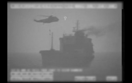 In this image made from video released by the U.S. military's Central Command, Iranian commandos fast-rope down from a helicopter onto the MV Wila oil tanker in the Gulf of Oman off the coast of the United Arab Emirates on Wednesday, Aug. 12, 2020.