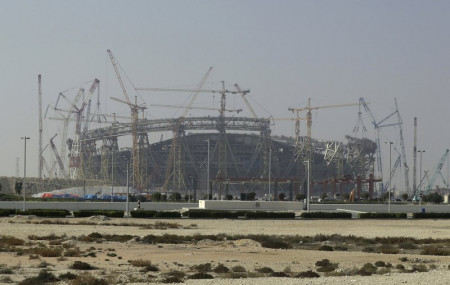 In this Dec. 20, 2019 file photo, construction is underway at the Lusail Stadium, one of the 2022 World Cup stadiums, in Lusail, Qatar.