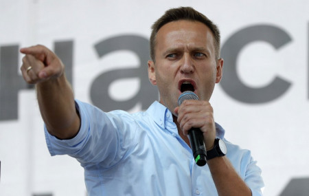 In this Saturday, July 20, 2019 file photo Russian opposition activist Alexei Navalny gestures while speaking to a crowd during a political protest in Moscow, Russia.
