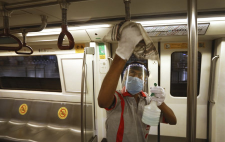 A workers sanitizes a metro coach in New Delhi, India, Thursday. Delhi Metro will open for service in a phased manner from Sept. 7, even as India has been reporting the highest single-day caseload in the world every day for more than three weeks.