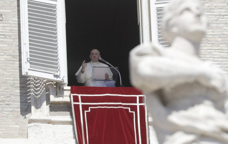Pope Francis recites the Angelus noon prayer from his studio window overlooking St. Peter's Square, at the Vatican, Sunday, Sept. 6, 2020.