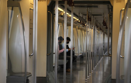 Commuters travel in an almost empty Delhi metro train in New Delhi, India, Monday, Sept. 7, 2020.
