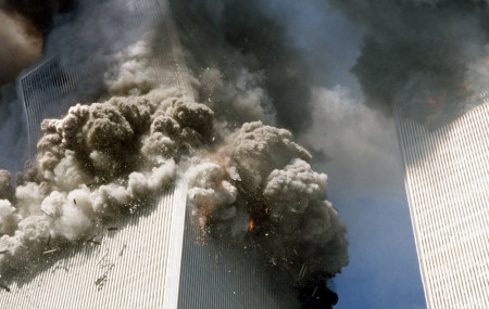 In this Sept. 11, 2001, file photo, the south tower of the World Trade Center, left, begins to collapse after a terrorist attack on the landmark buildings in New York.