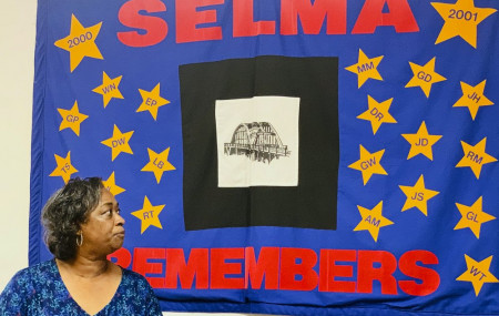 Mel Prince, executive director of Selma AIR, looks at a quilt that remembers people who lost their lives to AIDS, at her office in Selma, Ala., on Sept 3, 2020.