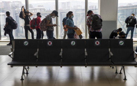 Passengers wait to board a humanitarian flight to Canada at the La Aurora international airport in Guatemala City, Thursday, Sept. 17, 2020.