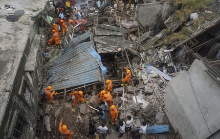 Rescuers look for survivors after a residential building collapsed in Bhiwandi in Thane district, a suburb of Mumbai, India, Monday, Sept.21, 2020.