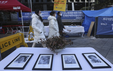 Portraits of late former South Korean comfort women are displayed near the Japanese Embassy in Seoul, South Korea, Friday, Jan. 8, 2021.