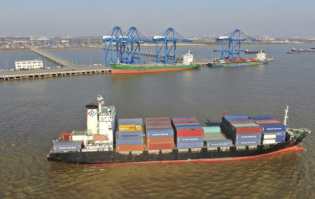A container ship leaves a port in Nantong in eastern China's Jiangsu Province, Dec. 20, 2020.