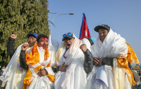 The all-Nepalese mountaineering team that became the first to scale Mount K2 in winter cheer as they arrive at Tribhuwan International airport in Kathmandu, Nepal, Tuesday, Jan. 26, 2021.