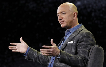 In this Thursday, June 6, 2019, file photo, Amazon CEO Jeff Bezos speaks at the Amazon re:MARS convention, in Las Vegas.