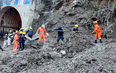This photograph provided by National Disaster Response Force shows NDRF personnel prepare to rescue workers at one of the hydropower project at Reni village in Chamoli district of Indian state of Uttrakhund, Monday, Feb. 8, 2021.