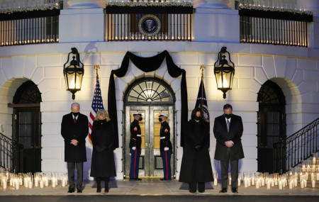 From left, President Joe Biden, First Lady Jill Biden, Vice President Kamala Harris and her husband Doug Emhoff, bow their heads during a ceremony to honor the 500,000 Americans that died from COVID-19, at the White House on Monday.