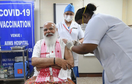 In this photo provided by Prime Minister of India Narendra Modi's twitter handle, Indian Prime Minister Narendra Modi is administered a COVID-19 vaccine in New Delhi, India, Monday, March 1, 2021.