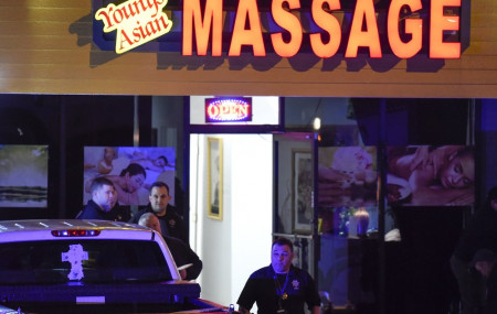 Authorities investigate a fatal shooting at a massage parlor, late Tuesday, March 16, 2021, in Acworth, Georgia.