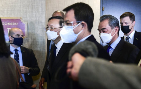 Chinese Communist Party foreign affairs chief Yang Jiechi, second from left, and China's State Councilor Wang Yi, second from right, depart the ballroom from the closed-door morning session of US-China talks in Anchorage, Alaska on Friday, March 19, 2021.