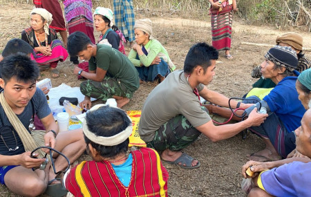 In this photo released by the Free Burma Rangers, members of the humanitarian group Free Burma Rangers carry out medical checkups on villagers in the northern Karen State, Myanmar Feb. 25, 2021.