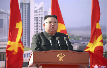 In this photo provided by the North Korean government, North Korean leader Kim Jong Un speaks during a ceremony to break ground for building 10,000 homes, in Pyongyang, North Korea, Tuesday, March 23, 2021.