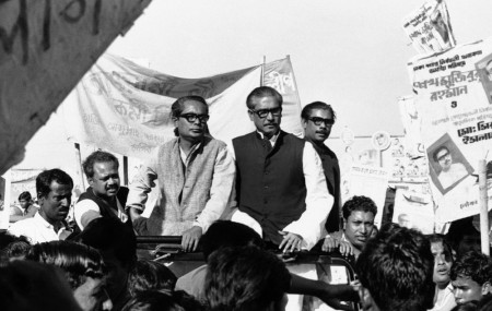 In this Dec. 7, 1970, file photo, Sheikh Mujibur Rahman, center on Rostrum, leader of East Pakistan's powerful Awami League, addresses an election rally in Dacca, East Pakistan.