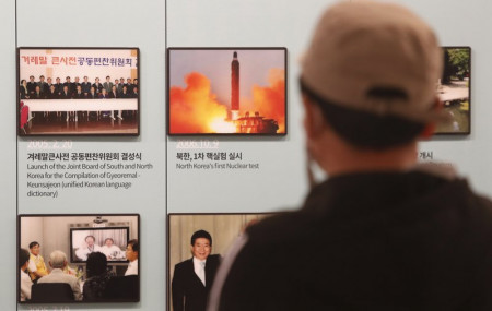 A photo showing North Korea's missile launch is displayed at the Unification Observation Post in Paju, near the border with North Korea, South Korea, Wednesday, March 24, 2021.