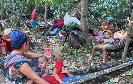 In this photo released by the Free Burma Rangers, Karen villagers gather in the forests as they hide from military airstrikes in the Deh Bu Noh area of the Papun district, north Karen state, Myanmar, Sunday, March 28, 2021.