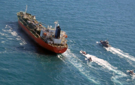 In this Jan. 4, 2021, file photo released by Tasnim News Agency, a seized South Korean-flagged tanker is escorted by Iranian Revolutionary Guard boats on the Persian Gulf.
