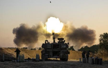 An Israeli artillery unit fires shells towards targets in Gaza Strip, at the Israeli Gaza border, Wednesday, May 19, 2021.