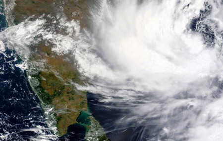 This Monday, May, 24, 2021, satellite image provided by NASA shows Cyclone Yaas approaching India's eastern coast.