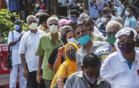 In this April 26, 2021, file photo, people queue up for coronavirus vaccine in Mumbai, India.