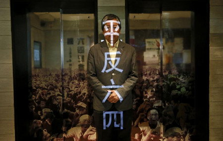In this May 28, 2014, file photo, Lee Cheuk Yan poses at the June 4 Museum his pro-democracy group operates in Hong Kong.
