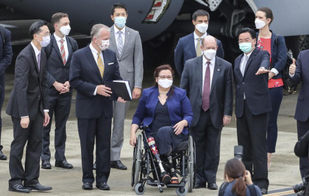 Taiwan's Foreign Minister Joseph Wu, second right, gestures as he welcomes U.S. senators on their arrival at the Songshan Airport in Taipei, Taiwan on Sunday.