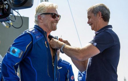 Virgin Galactic founder Richard Branson, left, receives a Virgin Galactic made astronaut wings pin from Canadian astronaut Chris Hadfield after his flight to space from Spaceport America near Truth or Consequences, New Mexico, Sunday