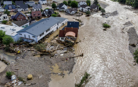 Damaged houses are seen at the Ahr river in Insul, western Germany, Thursday, July 15, 2021.
