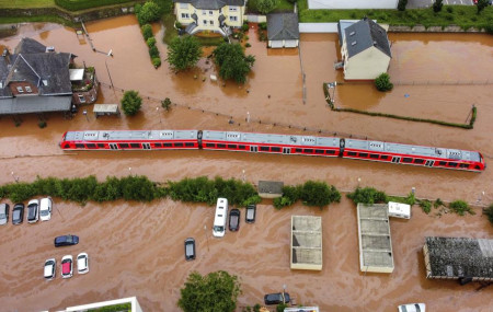 A regional train sits in the flood waters at the local station in Kordel, Germany, Thursday July 15, 2021 after it was flooded by the high waters of the Kyll river.