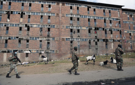 South African Defence Force soldiers on patrol alongside the male single sex hostels in Alexandra Township, north of Johannesburg, Thursday, July 15 2021.
