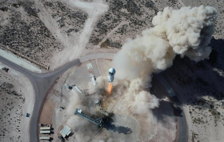 In this Jan. 14, 2021 photo made available by Blue Origin, the New Shepard NS-14 rocket lifts off from Launch Site One in West Texas.