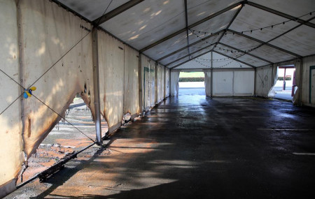 A view of the empty tent of a vaccination center after an arson attack on Saturday evening in Urrugne, southwestern France, Monday, July 19, 2021.
