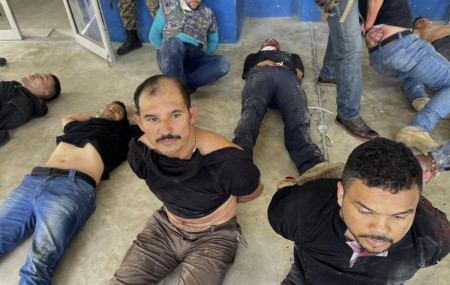 In this July 8, 2021 file photo, suspects in the assassination of Haiti's President Jovenel Moise are shown to the media at police headquarters in Port-au-Prince, Haiti.