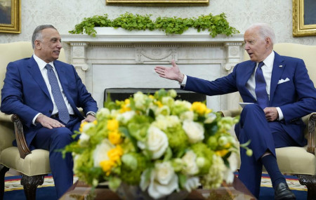 US President Joe Biden, right, speaks as Iraqi Prime Minister Mustafa al-Kadhimi, left, listens during their meeting in the Oval Office of the White House in Washington, Monday, July 26, 2021.