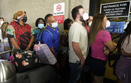 Passengers wait in a long line to get a COVID-19 test to travel overseas at Fort Lauderdale-Hollywood International Airport, Friday, Aug. 6, 2021, in Fort Lauderdale, Florida.