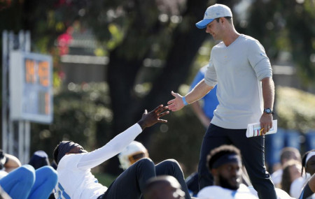 In this July 28, 2021 photo, Los Angeles Chargers head coach Brandon Staley greets wide receiver Mike Williams during practice at the NFL football team's training camp in Costa Mesa, California.